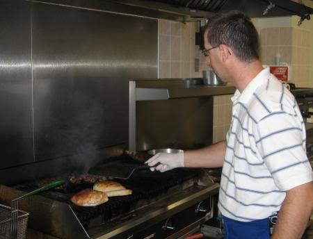 Enes grilling the Pljeskavica and Cevapcici